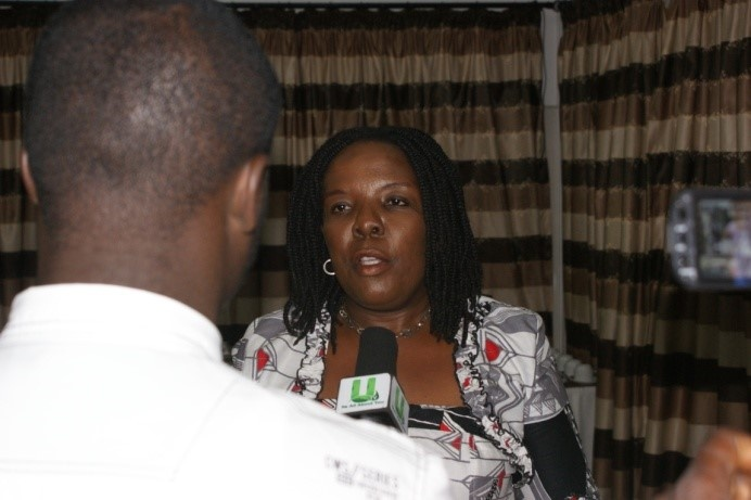 The representative of the Deputy Minister of Education in Charge of Tertiary Education, giving an interview at the meeting