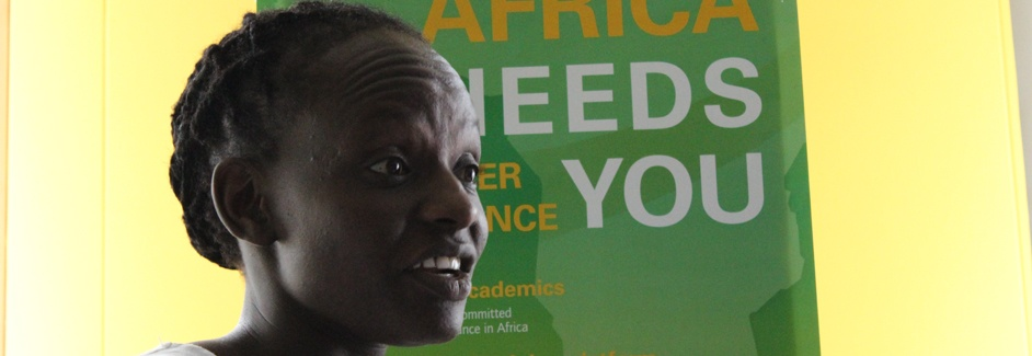 AGGN fellow in front of poster